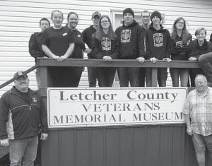 VOLUNTEERS — A group of the JROTC cadets volunteered a few hours at the Letcher County Veterans Museum, cleaning up inside and out. (Photo by Damaris Sexton)