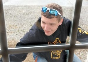 Cadet Luke Little was outside looking in on Saturday as he was washing windows at the Veterans' Museum in downtown Whitesburg. Little is a member of the Letcher County Central JROTC group that performed the community service. Others who participating were Cadets Austin Adams, Kody King, Joseph Gross, Jessika Moushon, Gracie Hall, Taylor Hall, Emily Collier, Chase McBee, Dalton Werely, Zack Kiser, Hannah Caudill, and Makayla House. (Photo by Damaris Sexton)