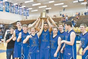 The 53rd District Champion Letcher Central Cougars hoisted their trophy into the air after Friday's win. (Photo by Chris Anderson)