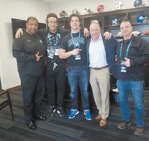 Ohio defensive end Alex Reigelsperger, center, plans to do what he can to convince other players to commit to UK now like he has.