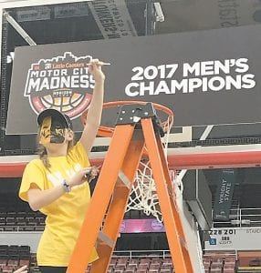 Jaylee Brennan, granddaughter of Jim and Jerri Elswick of Jenkins, took her turn cutting down the nets in Detroit recently after the Northern Kentucky University Norse won the Horizon League championship. The team is coached by her father, John Brennan.