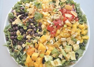 This photo shows a black bean and mango salad in Coronado, Calif. This dish is from a recipe by Melissa d'Arabian. (AP Photo)