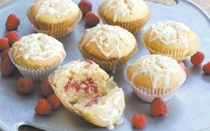 This photo shows lemon raspberry pound cake muffins. (AP Photo/J.M. Hirsch)