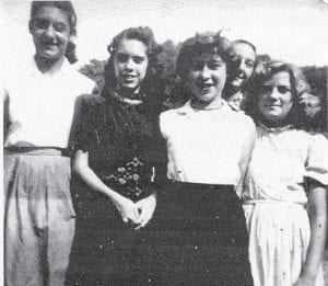 """The late Ann Miller is pictured with Mildred Necessary, Linda Pennington and Betty Sue Howard with James Howard in the background. Whitesburg correspondent Oma Hatton says they are all """"Marlowe kids"""", and all are grandparents except Linda (Pennington) Hall."""