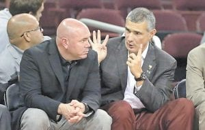 ON THE BENCH — South Carolina assistant head coach Matt Figger (left) listens as Gamecocks head coach Frank Martin discusses strategy. The Gamecocks now face No. 1 seed Gonzaga (36-1) in the national semifinals on April 1 in Phoenix, Ariz. The Bulldogs won the NCAA West Regional with an 83-59 victory over Xavier in San Jose, Calif. on Saturday night. Jim Nantz, Grant Hill, Bill Rafferty and Tracy Wolfson will be on the call for CBS. Tipoff is set for 6:09 p.m. (Photo courtesy The State, Columbia, S.C.)
