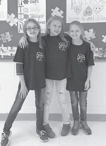 — Left to right, Taylor Baker, Delaney Pennell and Kylie Williams, all fourth graders at West Whitesburg Elementary School, were winners in the Autism Awareness Advocates t-shirt design contest for WWE students . Each student designed a t-shirt for Autism Awareness month in April. Not pictured is Jadeyn Absher, a first grader.