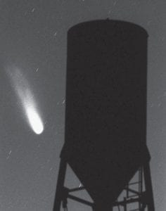 20 YEARS AGO IN THE SKY — The Comet Hale-Bopp is shown passing behind an old water tank in this timed exposure taken in Stanfield, Ariz., in 1997, where the comet was originally discovered by Thomas Bopp, a Glendale, Ariz., mechanic. The very best window for seeing the comet was in the evenings of March 26 to April 10, 1997. when moonlight didn't interfere, said Steve Kates, president of Sky Source Inc. of Phoenix. (AP Photo/Casa Grande Dispatch, Francisco Medina)