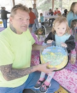 The Whitesburg Lions Club and the Jenkins Kiwanis Club held an Easter Egg hunt April 8 at Fishpond Lake, with over 150 people attending the event. The clubs provided 100 Easter buckets filled with 5,450 eggs, and candy, and plastic eggs filled with candy and money. Aubrey Bates, 2, was the winner of an Easter cake from Dairy Queen. She is the daughter of Tiffany and Anthony Bates of Jenkins, and is pictured with her grandfather, Sid Tolen. This was the first combined effort for the community. Donors were Kwik Mart, Food City, Double Kwik, Neon Food World IGA, and Dairy Queen.