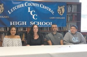 Two Letcher County Central High School basketball players signed scholarship offers during a ceremony at the school on Tuesday afternoon. Above, Torell Carter of Mayking (second from right), the school's first-ever first-team All-State player, signed a scholarship offer from Berea College. Below, Austin Caudill (second from left) signed an offer from Alice Lloyd College. Pictured with Carter are, from left, his sister, Daysha Carter, an LCC sophomore; his mother, Lucy Carter; and brother Diondre Carter, an LCC freshman. Another brother, Rakim Mitchell, was unable to attend. Seen in the photo with Caudill, of Isom, are his mother, Deanna Caudill; his father, Mark Caudill, and LCC assistant coach Winston Lee. School officials praised both players for having high academic achievements in addtion to their hoops skills, noting that both did well on their college entrance exams in addition to maintaining high grade point averages while playing for the Cougars. (Eagle photos)