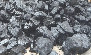 """BLACK GOLD — If all the coal mined in Letcher County since 1900 was loaded onto a single train of 100-ton rail cars known as """"gons,"""" the train would reach around the Earth twice at the Equator and the coal on it would be worth as much as $98.4 billion. (AP Photo)"""