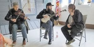 Playing old-time music at the Hemphill Community Center's first session of the Back to Our Appalachian Roots program are (left to right) John Haywood, Kevin Howard and Jaden Sturgill.