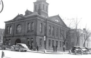 """Pictured at top is an addition to the rear of the Letcher County Courthouse taken shortly after the """"annex,"""" as it was known, was constructed in 1937. Pictured at right is the courthouse as seen from the corner of Main Street and Webb Avenue, also taken in 1937. You can see the annex in the smaller photo as well. (Photo from Goodman-Paxton Collection, courtesy of the University of Kentucky Digital Library)"""