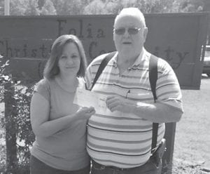 — Eolia Christian Community Outreach recently received a $7,000 grant from the EQT Foundation. Pictured are Amy Gross, ECCO Administrative Assistant, and Kester Halcomb, Vice President of the Board. ECCO representatives said they sincerely thank EQT for considering ECCO's food pantry and community in their giving.