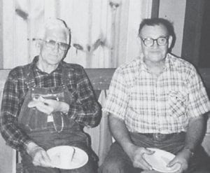 The late Bill Howard and the late Willard Maggard are pictured at a church dinner at Cowan Church a long time ago.