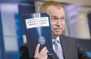 Budget Director Mick Mulvaney held up a copy of President Donald Trump's proposed fiscal 2018 federal budget Tuesday. (AP Photo)