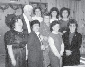 Pictured in 1984, the last Christmas the family was all together, are the late Bill and Cinda Howard and their seven daughters, Oma, Louise, Kathleen, Della, Betty, Joanne and Judy.