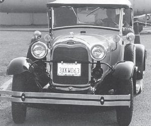 Everett Vanover is pictured in his 1929 Model A Ford Roadster with a rumble seat, participating in a parade at Travis Air Force Base where he won for best looking car.