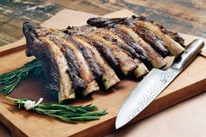 """This photo shows beef rib """"Brontosaurus Bones"""" at the Institute of Culinary Education in New York. This dish is from a recipe by Elizabeth Karmel. (AP Photo)"""