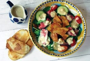 This photo shows a warm steak and potato chip salad with blue cheese dressing in New York. This dish is from a recipe by Sara Moulton.