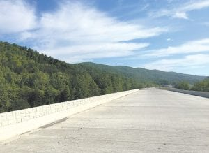 This bridge over the Poor Fork of the Cumberland River connects two unpaved, but short stretches of new highway.