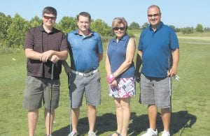 A golf team fielded by Community Trust Bank won the Letcher County Chamber of Commerce/Whitesburg Rotary Club Annual Golf Scramble held June 2 at Raven Rock. Team members are, from left, Craig Winchell, Bryan Fleming, Joan Curry and Scott Frazier. The event was co sponsored by Whitesburg ARH and Community Trust Bank Inc. The funds raised will be used towards scholarships for Letcher County students. The Chamber and Rotary Club thank all hole sponsors, the Raven Rock Golf Club and volunteers who helped with the event, including Rachel Breeding, Lee Ann McIntyre, Abby Gabbard and Hunter Hall.