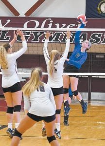 Letcher Central sophomore Olivia Hammock leaps to spike the ball in the Lady Cougars' season-opening loss at Pikeville. The Lady Cougars have since been on a roll, however, winning four straight matches, all against district foes Knott Central and June Buchanan.