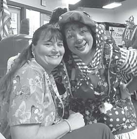 Carmen Brock is photographed with a clown that performed at Senior Citizens in the Clowns for Christ performance.
