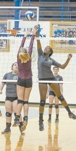 Jenkins' Lala Watts tapped the ball over the net in Tuesday's 3-0 district tournament loss to Pikeville. (Photo by Chris Anderson)