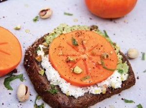 This photo shows avocado and goat cheese toast with persimmon in Bethesda, Md. (Melissa d'Arabian via AP)