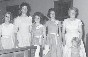 At Marlowe School graduation are (left to right) Glenda Wilson, Jo Ella Taylor Sturgill, Linda Lou Frazier, Rosemary Dixon, teacher Mrs. Marcum, and (front) Effie Dixon Hatton.