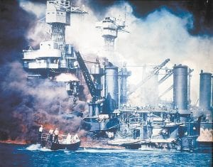 76 YEARS LATER — In this Dec. 7, 1941 file photo, a small boat rescues a USS West Virginia crew member from the water after the Japanese bombing of Pearl Harbor, Hawaii. Colby Adams, a 19-year-old sailor from Letcher County, was feared dead in the attack but was later found alive and well after his family had already received a telegram informing them that he was missing and presumed dead as a result of the attack. (AP Photo)