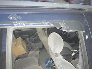 Both in statements to police and sworn testimony before a Letcher Circuit Court Jury, three friends who were with Michael Hogg on the night he was stabbed to death say that suspects James Huffman IV and Patrick Smith tried to break out the windows of Hogg's Jeep Cherokee after the stabbing. Pictured above is what is left of a window visor the three said was broken while they were trying to escape and get to the Whitesburg hospital for treatment of stab wounds.
