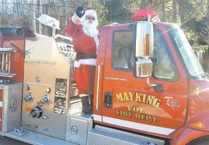 Santa Claus made an early visit to Letcher County on Saturday to make sure everything is in order for his return visit here early Christmas morning. While in Letcher County, Santa was treated to a community breakfast at the Mayking Volunteer Fire Department, after which he climbed aboard a pumper truck and had volunteers drive him to the Thornton, Mayking, and Craft's Colly areas, where he practiced giving out presents to the lucky children who saw him. Santa will return aboard his sleigh next week.