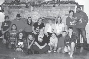 The family of Joyce and Charlie Whitaker got together to celebrate Christmas and family. Included were Joyce Whitaker, her daughter Suzy Madden, five grandchildren, two granddaughters-in-law, and seven great-grandchildren. The family ranges in age from 88 years to baby Evan at four weeks.