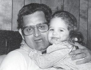 Joy Yonts Hampton shares a hug with her Papaw Marshel Tacket.