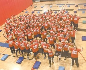 Physical fitness trainer Brandy Cook of Whitesburg, pictured front second from left, is leading more than 100 Letcher County residents who have accepted a 12-week challenge to see who can lose the most weight during a series of workouts at the Letcher County Recreation Center in Whitesburg. The challenge began on New Year's Day.