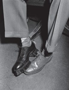"It happened in the Fifties This photograph appeared in newspapers across the U.S. on January 12, 1950 and shows a new invention — a shoe with bristles at the sole used to polish a regular shoe, from the Los Angeles (Calif.) Brush Manufacturing Corporation. Also appearing (not shown here) were photographs of a pair of ""Sandal Scrubs,"" wooded beach sandals with bristled soles, so that one could scrub floors standing up. (AP Photo)"