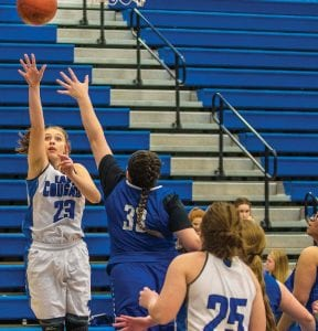 Letcher Central's Courtney Hayes, an eighth-grader, put up a jumper underneath the basket in Monday's 70-27 win over June Buchanan. The win gave the younger Lady Cougars a chance to sharpen their skills, with many of the game's minutes going to LCC's younger players.(Photo by Chris Anderson)