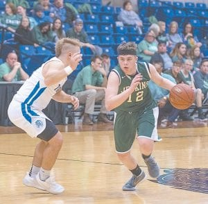 Including this Thursday's home tilt against Pikeville, the Jenkins Cavailers will have 11 more chances to notch their first win of the season. In the photo above, Cavaliers point guard Kobe Brown drove the ball during an 81-31 loss to Paintsville in the All 'A' 15th Region Tournament. The Cavs lost last week to Letcher County Central (77-46) and Magoffin County (81-52). They will play Bell County at home Saturday in a 3:30 p.m. matchup and will host a rematch with Magoffin County February 5. The Cavs will remain home February 7 against Jackson City. (Photo by Chris Anderson)