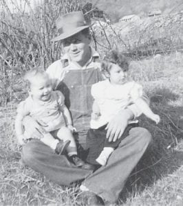 Tommy Taylor holds his daughter Jo Ella Taylor Sturgill and her cousin Carol Ann Nease. The photo was taken around 1949.