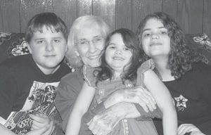 Evelyn Mullins Yonts holds Story Eliza Hampton with Seth Lennon Hampton and Drew Eden Hampton, three of her great-grandchildren, taken at Thanksgiving 2016.