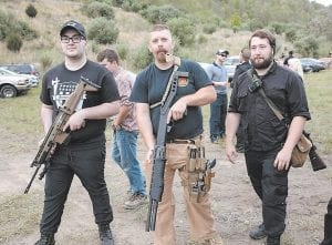 Attendees at the white nationalist assembly that took place on Ellis Keyes's property at Loves Branch last fall showed off their weapons the evening before they attended a controversial rally in Pikeville. (Photo by Tod Seelie, The Village Voice)