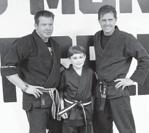 — Six years of hard work, dedication, determination, staying the course and not making excuses and on February 2 at Larry Adams Martial Arts, Jaxson Napier, a son of Kim and Freddie Napier of Pikeville, earned his Black Belt. Jaxson started as a five-year-old Little Dragon and is now an 11-year-old Black Belt. Pictured are Larry Adams, Jaxson Napier, and John Epling