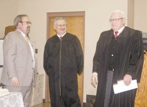 — Letcher Circuit Judge James W. Craft II and Kentucky Supreme Court Justice Samuel T. Wright (center) congratulate newly appointed Court of Appeals Judge Gene Smallwood (right) at his swearing in on Monday in the Letcher Circuit Courtroom. All three are from Letcher County.