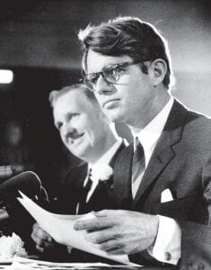 When Kennedy visited Neon … One week after his meetings with residents in Neon and elsewhere in Letcher County and eastern Kentucky, U.S. Senator Robert F. Kennedy said he would meet soon with U.S. Rep. Carl D. Perkins (D-Hindman) and U.S. Sen. John Sherman Cooper (RKentucky) to prepare a list of recommendations based on Kennedy's observations during a multi-day trip to examine poverty conditions in Appalachia. In the photo above, Kennedy (foreground) and Perkins, chairman of the House Labor Committee, were in Neon on February 15, 1968, for a public hearing held in the Fleming-Neon Gymnasium. (AP Photo)