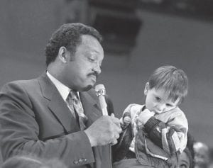 … and Jackson visited Hazard Presidential candidate Jesse Jackson shrugged as a shy four-year-old Walter Moore of Hazard looked away during a campaign stop in Hazard and elsewhere in Perry County on Thursday, Feb. 25, 1988. The visit by Jackson, who was seeking the Democratic nomination for president, came 20 years after the late Robert F. Kennedy visited Letcher County and elsewhere in eastern Kentucky. (AP Photo/Ed Reinke)