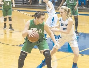 Jenkins' Lindsay Rose looks to dribble around the defense in 76-55 loss to Shelby Valley in the opening round of the 59th District girls' basketball tournament. With the loss, Jenkins finishes the season with a 6-25 record.