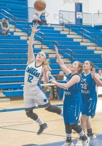 Letcher Central's Camryn Parks puts up a shot underneath for two of her 13 points in Monday's win over June Buchanan in the opening round of district tournament play. (Photos by Chris Anderson)