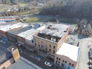 The Daniel Boone Hotel building and its crumbling roof can be seen on Whitesburg's Main Street.