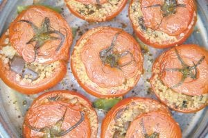 This photo shows Quinoa-Stuffed Tomatoes. This dish is from a recipe by Melissa d'Arabian.